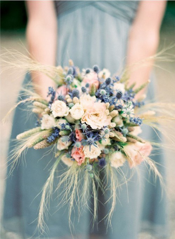 The blue colour paired with the soft pinks creams gives a bit of silver glow to the bouquet. Love the use of the wispy wheat sprigs to give more movement.